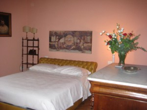 lovely bedroom, even in pink - and they left us fresh flowers!