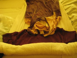 7.  Lay clothing on a towel and roll the towel over them.