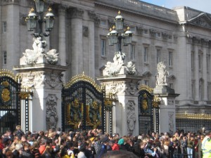 Palace gates with throngs of people