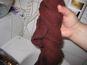 6.  Wring the clothing out over the sink.