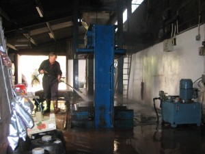 Mr. Wilkins spraying down the apple pressing room