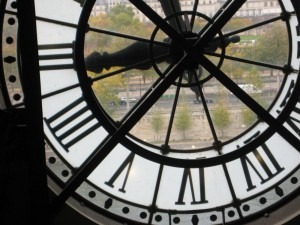 One of the old train station clocks-- with a view of the Seine River